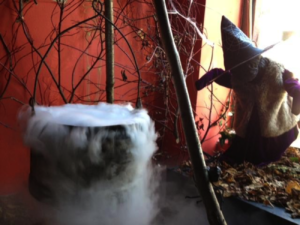 Halloween dry ice fog flowing from a Halloween cauldron style container.