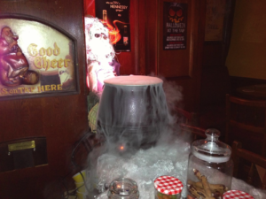 Halloween dry ice fog flowing from a Halloween cauldron style conatiner.